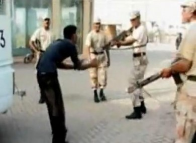 Still from the video footage of Shah being attacked by soldiers in June 2011.