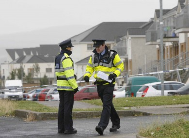 Gardaí near the scene of the crime in Tallaght yesterday.