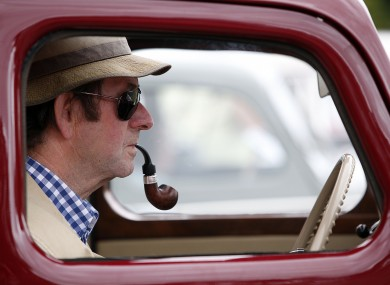 A vintage car enthusiast gets into the spirit at the 34th Irish Veteran & Vintage Car Club Powerscourt Picnic today.