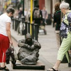 A statue of a homeless man catches the eye of passers-by in Dublin as part of a DePaul art project on homelessnes. (Sam Boal/Photocall Ireland)