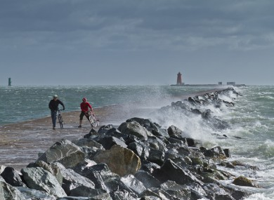 Cyclists brave the storm at the Great South Wall near Poolbeg yesterday.