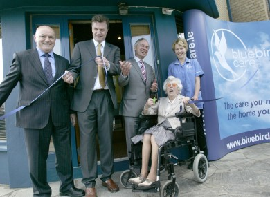 From left: Willie Byrne and David Bruton of Bluebird Care, Minister Bruto