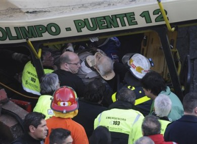 One of the injured passengers is carried out of the train involved in today's crash in Buenos Aires.