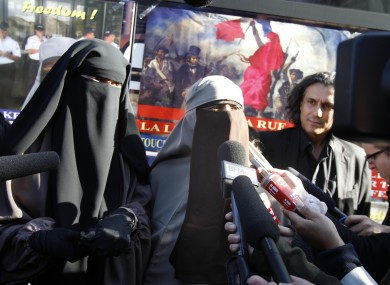 Kenza Drider, centre, addresses reporters after announcing that she will be candidate for the 2012 French presidential elections