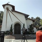 News photographers outside St Nicholas Episcopal church in where the stolen painting was found. (AP Photo/Nick Ut)