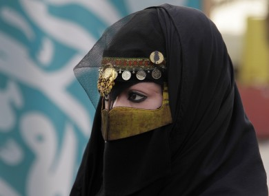 A Saudi women attends the traditional Arda dance, or War dance, during the Janadriyah Festival of Heritage and Culture, on the outskirts of the Saudi capital Riyadh