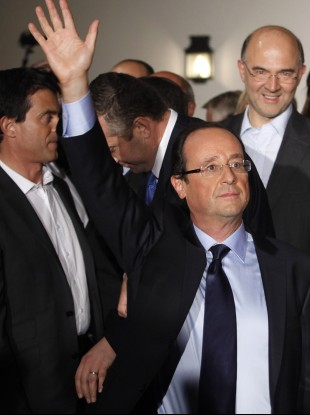 Francois Hollande waves after winning the Socialist Party's primary vote.