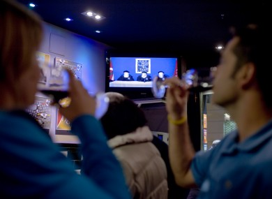 A couple drink whilst they look at Spanish TV at a bar in Pamplona northern Spain, showing members of the Basque separatist group ETA.