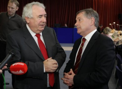 Brendan Howlin, right, speaks to Joe Costello today at Dublin Castle.