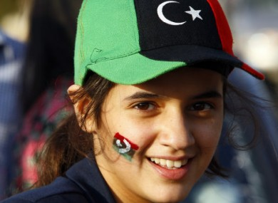 A Libyan girl dons the colours of the new Libyan flag ahead of today's declaration of liberation.