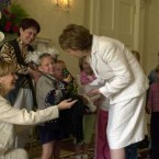 McAleese held multiple receptions for the Chernobyl Children's Project. Here she is thanked by Adi Roche and 8-year-old Masdha Liaschanina for her support in 2003.