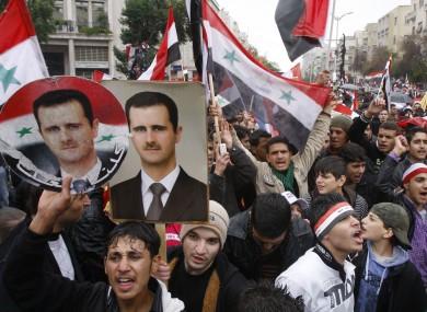 Pro-Syrian regime protesters, shout pro-Syrian President Bashar Assad slogans during a demonstration in Damascus