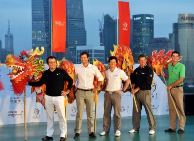 Francesco Molinari, Adam Scott, Rory McIlroy, Lee Westwood and Keegan Bradley of the United States perform traditional dragon dance at the opening ceremony.
