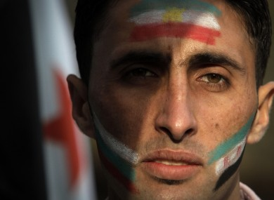 Fathi, 23, a Syrian refugee, attends a protest against the Syrian regime in Sofia, Bulgaria, 6 Nov 2011.