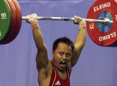 Indonesia's Jadi Setiadi competes in the clean and jerk of the Men's 56 kg category at the 26th Southeast Asian (SEA) Games in Palembang, South Sumatra, Indonesia, Friday, Nov 18, 2011.