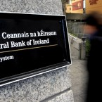 17 November 2010:A woman enters the offices of the Central Bank in Dublin. On 17 November Brian Cowen appeared on TV insisting that talks between Dept of Finance officials and representatives of the EU. IMF and EC were not in preparation for a bailout. (AP Photo/Peter Morrison, File)