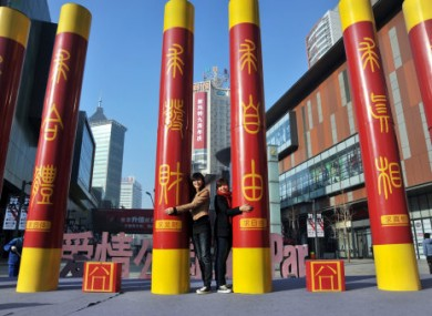 Six pillars mark Singles Day on a shopping street in Shenyang City in the northeast Chinas Lianoning province.