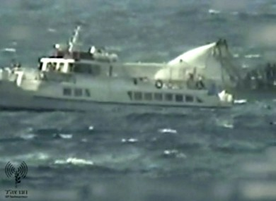 This video image released by the Israeli Defense Ministry on Friday appears to show a military boat hosing water on a civilian boat believed to be one of the two protest boats