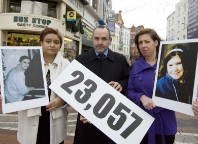 ( L to R) Donna Price with a photo of her son Darren (18), who died in 2006 , Noel Brett, Chief Executive of the Road Safety Authority and Caitriona Quinn with a photo of her daughter Cait (11) who died in 2009