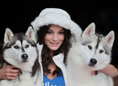 Model Karen Fitzpatrick with Siberian Huskies Michelle and Flint pictured at the opening of Kilkenny on Ice today.