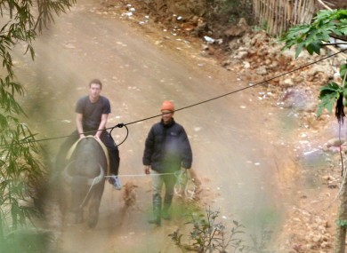 Zuckerberg rides a water buffalo in northern resort town of Sapa in Lao Cai province in Vietnam on 26 December.