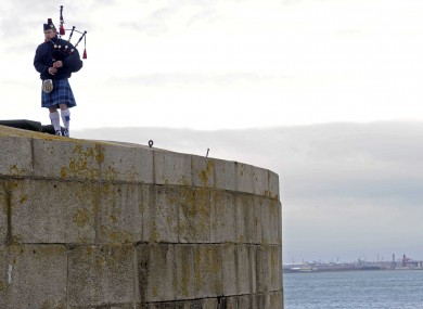 Piper Paul McNally plays at a memorial ceremony for those who have lost their lives at sea.
