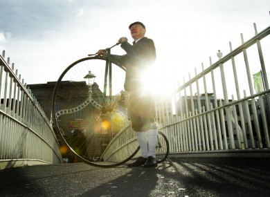 Pete Matthews with his penny farthing on Dublin's Ha'penny Bridge for the launch of the Temple Bar Tradfest today