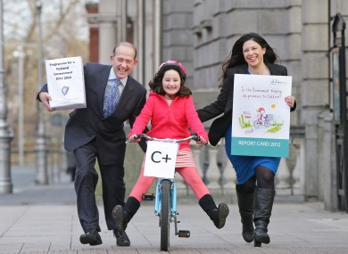 Paul Gilligan, Chair of the Children's Rights Alliance, 8-year-old Ava Reid and Tanya Ward, Chief Executive of the Children's Rights AlliancePic:Marc O'Sullivan.