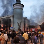 Egyptians surround the burned Bab Sharq police station in Alexandria as anti-Mubarak protesters gather again in Egypt's cities. (AP Photo/Ahmed Mohammed/PA Images)