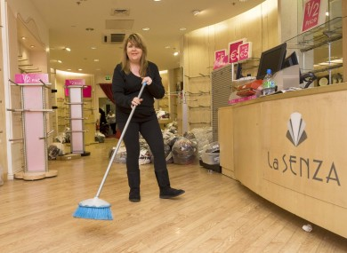 Evelyn Gaynor, the manager of the Henry Street branch of La Senza, sweeps floors at the Liffey Valley branch during the solidarity sit-in.