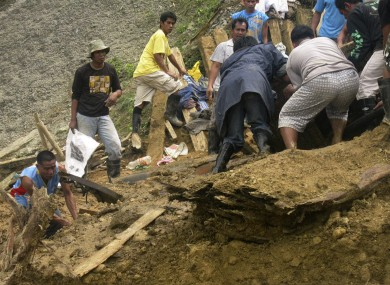 Residents dig through the rubble following a landslide that occurred at the small-scale mining community of Pantukan, Compostela Valley in southern Philippines.