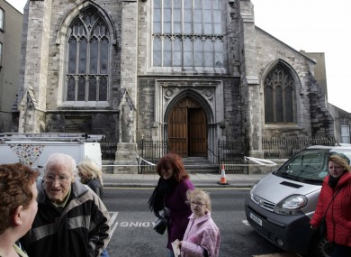 Local residents outside the church, the day after the blaze