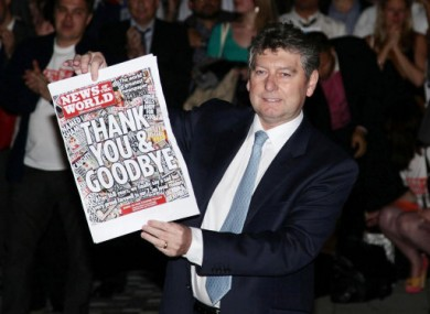 Myler with the final copy of the News of the World following the phone hacking scandal which brought about the paper's demise.