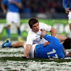 Not only does Farrell show ice cool poise under the pressure of kicking, he is also manning up to the physicality required in midfield. This picture is testimony to that as he lays out Tommaso Benvenuti. The tackle would have resulted in seven points for England had the whistle not already been blown.<span class=