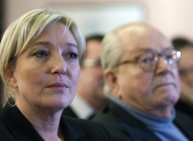 Le Pen with her father Jean-Marie at a meeting in Paris today.