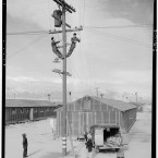Electric line repair crew at work in the camp. (Library of Congress, Prints & Photographs Division)