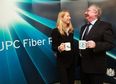 CEO of UPC Ireland Dana Strong with Minister for Communications, Energy & Natural Resource Pat Rabbitte TD