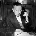 Manchester United assistant manager Jimmy Murphy, who didn't travel to Belgrade with the team due to his commitments as Welsh national manager, fields telephone inquiries from concerned fans just hours after the disaster.