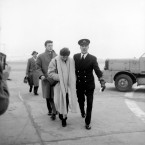 Accompanied by an Air Steward, Miss Leach, friend of Manchester United's Duncan Edwards, walks to a plane at Manchester Airport to fly to Munich.