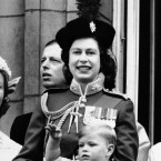 Queen Elizabeth stands with Prince Andrew, who waves, on the balcony of Buckingham Palace on June 2, 1962 to mark the ninth anniversary of her official coronation. (The Queen was not coronated until 1953, as it is considered inappropriate to hold an official ceremony while the monarch is in mourning for their parent).
