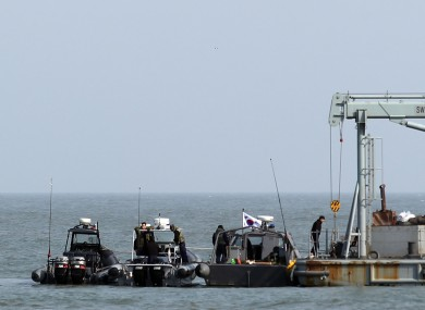 Navy sailors work at a floating base near South Korea's western Yeonpyong Island.
