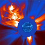 A large coronal mass ejection recorded in January 2002. The blue ultraviolent image of the sun was superimposed over the image of the particle blast for scale. (NASA/the Solar Dynamics Observatory)