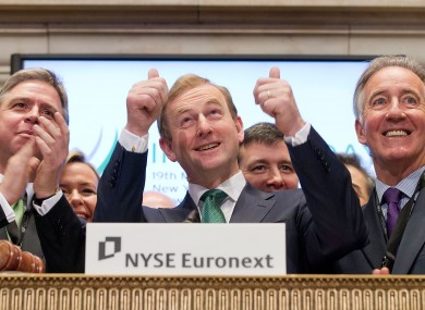 The Taoiseach gives the thumbs up after ringing the opening bell.