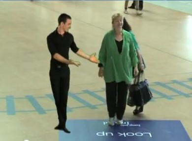 Woman dances with virtual Irish dancer