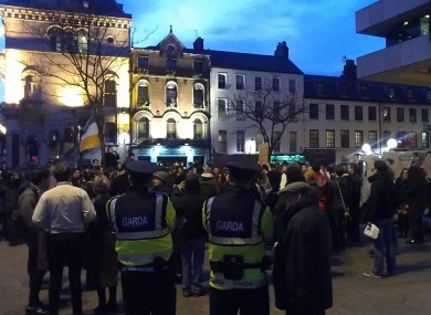 With the gardaí present, Occupy Dame Street protesters assembled outside the Central Bank tonight promising to reform in the wake of their camp being  taken down earlier today.