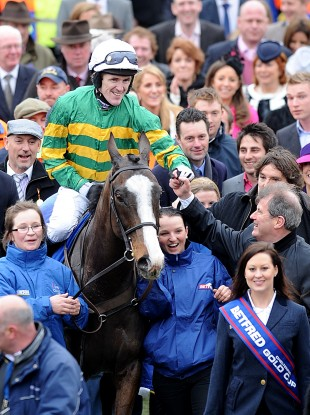 Tony McCoy takes the congratulations of owner JP McManus.