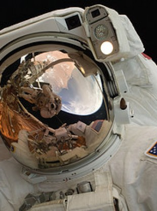 Space walking astronaut John Grunsfeld