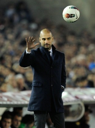 Barcelona head coach Pep Guardiola throws back the ball last night.