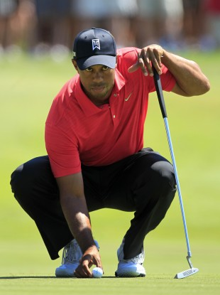 Tiger Woods lines up a putt on the second green.