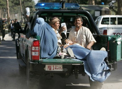 Afghan victims of the suicide attack are transported in the back of a police truck in Guzara, Herat province earlier today.